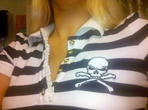 Juicy Couture collared striped shirt, $34.99. Skull and crossbones patch purchased at Michael's, $2.99. You don't have to be a sewing expert to adhere spice up your wardrobe. The patch shown is an iron on and takes less than five minutes to complete!
