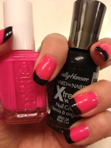 Pink Essie hue in Short Shorts, tipped with Sally Hansen's Xtreme Wear in Black Out.
