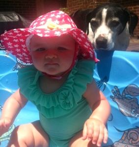 Cute baby bombed by Spanky the dog.