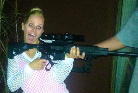 Crazy bitch with a gun.