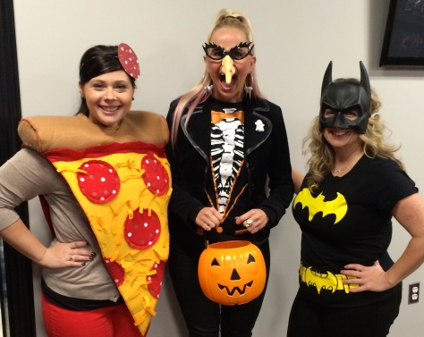 A pizza, a ghoul and bat girl.