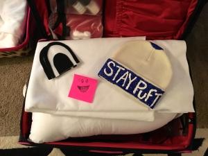 Shoving shit into my suitcase.