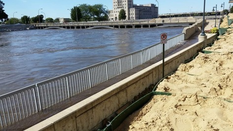 Four feet of sandbags and still a raging river in Cedar Rapids.